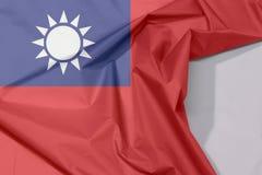 中华队台湾织品旗子绉纱和折痕与白色空间 免版税库存照片