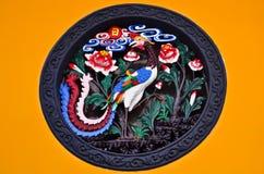 中国五颜六色的装饰品孔雀 免版税库存照片