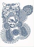 中国人剪切传统纸张的模式 库存图片