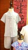 中国传统亚麻制衣裳和qipao childern 图库摄影