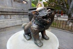 中国古铜色狮子 库存图片