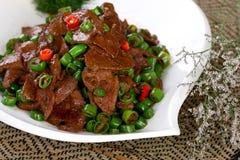 中国可口盘食物油煎了热肝脏猪肉 免版税库存照片