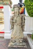中国哲学家雕象在Wat Pho曼谷 免版税库存图片