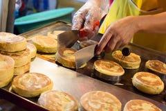 中国小圆面包油煎的饺子 库存照片