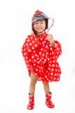 中国小女孩佩带的雨衣和起动 图库摄影