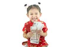 中国新年好 用传统汉语的逗人喜爱的亚裔女孩 图库摄影