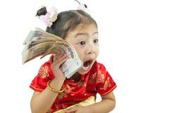 中国新年好 用传统汉语的逗人喜爱的亚裔女孩 库存照片