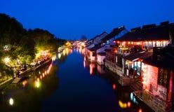 中国晚上场面村庄水 库存图片