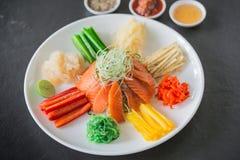 中国生鱼沙拉,中国的当地人 库存图片