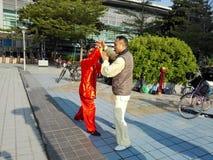 中国男人和妇女实践上实践tai池氏 图库摄影