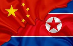 中国的北朝鲜& x28旗子和旗子; 民主党People& x27; s大韩民国& x29; 免版税图库摄影