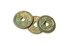 中国的古老古铜色硬币白色的 库存照片