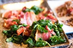 中国盘用油煎的猪肉 库存图片