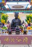 中国神的金黄雕象 免版税库存图片