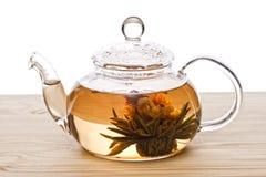 中国花玻璃状莲花茶茶壶 免版税库存照片