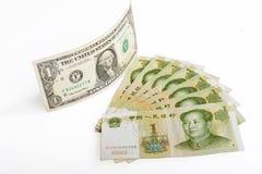 中国金钱rmb钞票和美国美元 库存图片