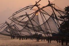 中国黄昏捕鱼网 免版税图库摄影