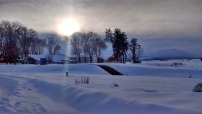 中央俄勒冈多雪的日落农场 库存图片