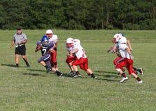 中学橄榄球队 图库摄影