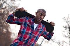 中断人踩滑板的采取 免版税库存照片