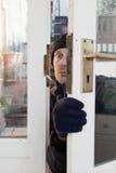 中断在抢劫证券的窃贼 库存照片