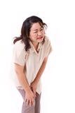 中部变老了遭受膝盖痛苦,联合伤害的妇女 免版税库存图片