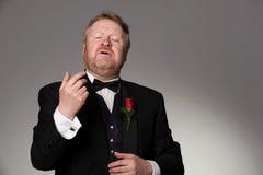 中部年迈的歌剧歌手执行 库存照片