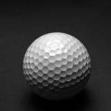 击中铁行动的球高尔夫球 图库摄影