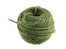 串或麻线绿色球在白色背景 免版税库存图片