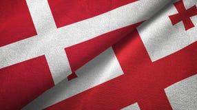 丹麦和乔治亚两旗子纺织品布料,织品纹理 库存例证