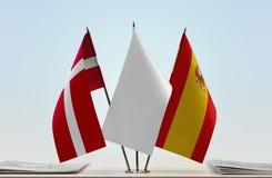 丹麦和西班牙的旗子 免版税图库摄影