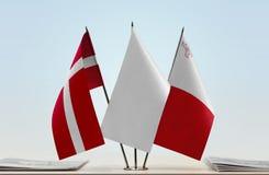 丹麦和马耳他旗子  免版税库存照片