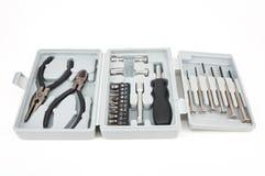 为修理设置的工具箱 钳子和螺丝刀用不同的喷管 库存照片