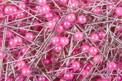为刺绣的特写镜头桃红色针工具 图库摄影