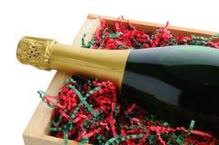 为圣诞节包装的香宾瓶 免版税库存照片