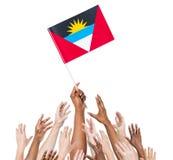 为安提瓜和巴布达旗子举的胳膊  库存图片