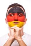 为德国祈祷 面孔画象德国足球迷为国家队祈祷 库存照片