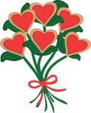 为情人节导航红色心形的曲奇饼安排了在与红色丝带的曲奇饼花束 免版税库存照片