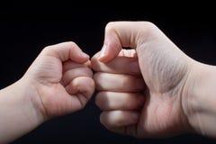 为拳头姿态关闭的手 图库摄影
