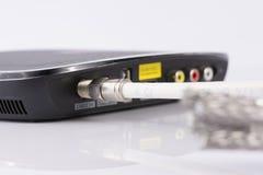 为数字式电视,有线电视,在白色的数据缆绳缚住 免版税图库摄影