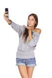 为照相的女性在巧妙的电话 库存照片