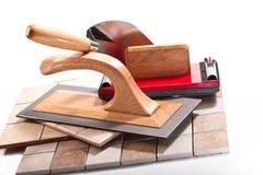 为的工具与陶瓷砖一起使用 库存照片