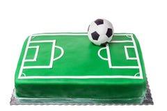 为足球运动员、足球场和球结块 图库摄影