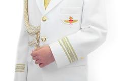 为他的第一个圣餐打扮的年轻男孩 库存照片