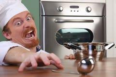 主厨滑稽的年轻人 免版税库存照片