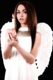 举一个蜡烛的美好的年轻天使 库存照片