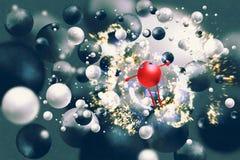 举在浮动black&white球中的红色球胳膊 图库摄影