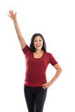 举她的手的美丽的西班牙妇女查出在白色 库存照片