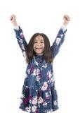 举她的胳膊的愉快的女孩 免版税图库摄影