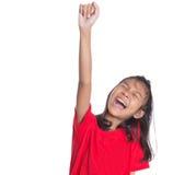 举手的年轻亚裔女孩III 库存图片
